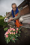 © Joel Goodman . 18 May 2013 . Gita Bhavan Hindu Temple , Withington Road , Whalley Range , Manchester . Professor Nawal Prinja waters newly planted plant on the temple grounds in front of the temple . Commemorative service to celebrate the handover of the Green Kumbh Yatra (green journey pot or environmental pilgrimage) at the Gita Bhavan Hindu Temple in Manchester . The pot has travelled to the Maha Kumbh Mela , Kenya , Nepal and the Western Wall in Jerusalem along the way . At every place of rest an environmental action must be taken to reflect the pot's environmental significance . It's due to travel to Leicester and feature in an outdoor procession in London on 24th May 2013 . Photo credit : Joel Goodman