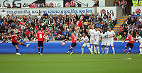 Pictured: Memphis Depay of Manchester United takes a free kick against a Swansea wall Sunday 30 August 2015<br /> Re: Premier League, Swansea v Manchester United at the Liberty Stadium, Swansea, UK