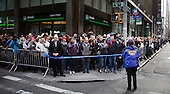 People gather on a sidewalk to watch as United States President-elect Donald Trump's motorcade passes by en route to LaGuardia Airport in New York, New York, USA, 08 December 2016.<br /> Credit: Justin Lane / Pool via CNP