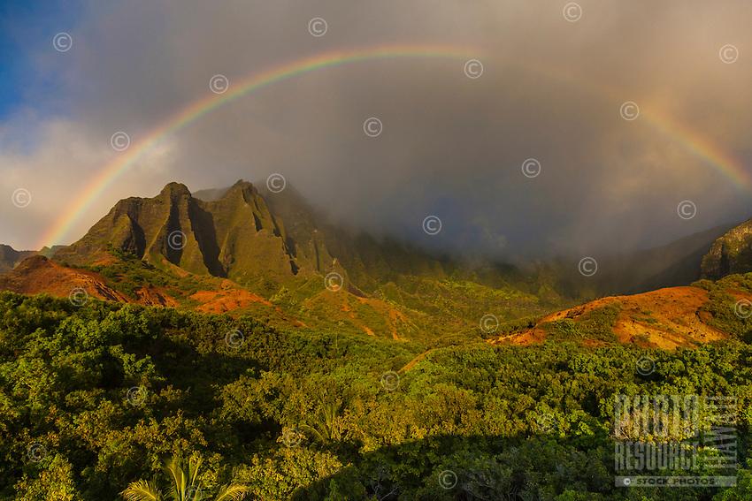 Rainbow over Kalalau valley on the na pali coastline of Kauai.