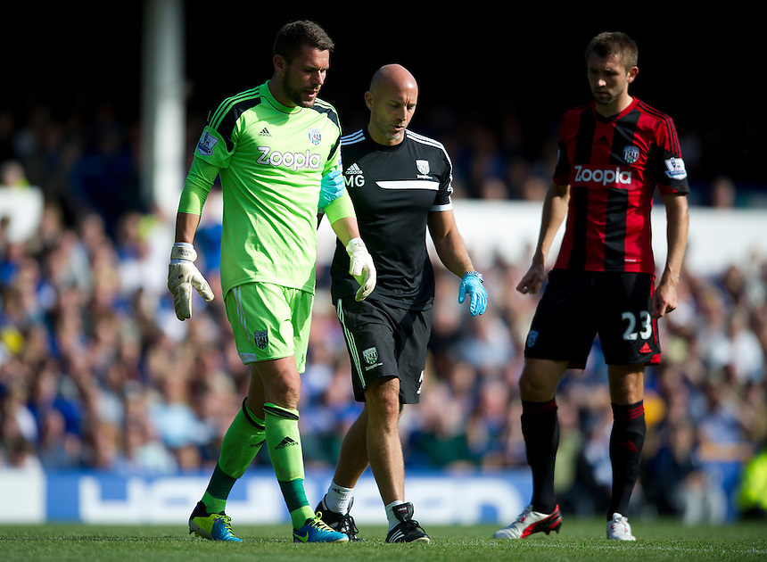 West Bromwich Albion's goalkeeper Ben Foster leaves the pitch injured<br /> <br />  (Photo by Stephen White/CameraSport) <br /> <br /> Football - Barclays Premiership - Everton v West Bromwich Albion - Saturday 24th August 2013 - Goodison Park - Liverpool<br /> <br /> &copy; CameraSport - 43 Linden Ave. Countesthorpe. Leicester. England. LE8 5PG - Tel: +44 (0) 116 277 4147 - admin@camerasport.com - www.camerasport.com