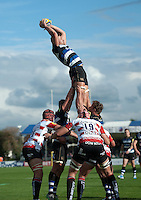 Charlie Ewels of Bath Rugby rises high to win lineout ball. West Country Challenge Cup match, between Gloucester Rugby and Bath Rugby on September 13, 2015 at the Memorial Stadium in Bristol, England. Photo by: Patrick Khachfe / Onside Images