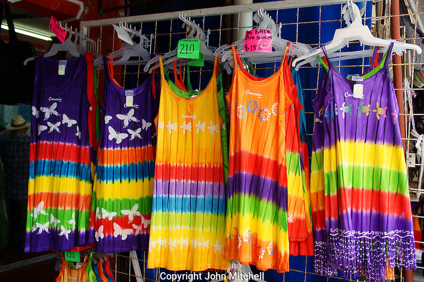 Colourful dresses in Mercado 28 souvenirs and handicrafts market in  Cancun, Mexico      .