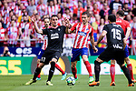 Gabriel Fernandez Arenas of Atletico de Madrid (R) fights for the ball with Enrique Garcia of SD Eibar (L) during the La Liga match between Atletico Madrid and Eibar at Wanda Metropolitano Stadium on May 20, 2018 in Madrid, Spain. Photo by Diego Souto / Power Sport Images