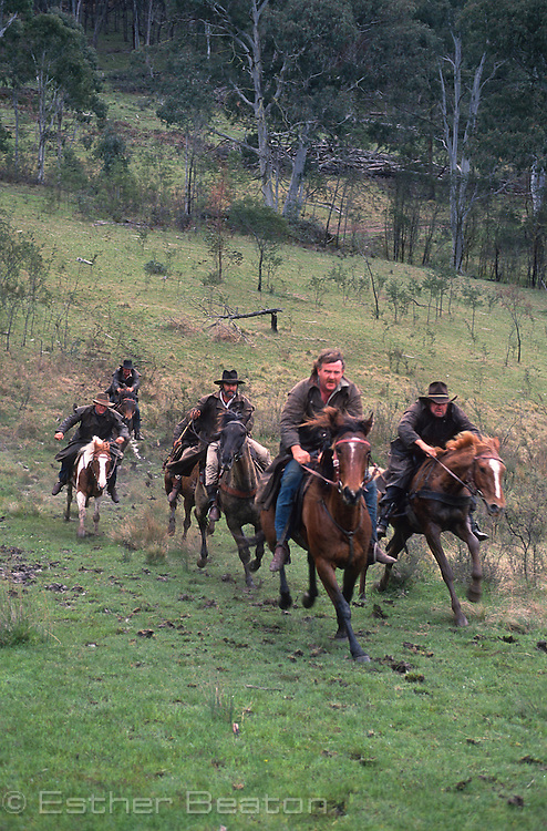 Mountain Cattlemen or stockman, racing across meadow. Near Mt Buller, Snowy Mountains, Victoria.
