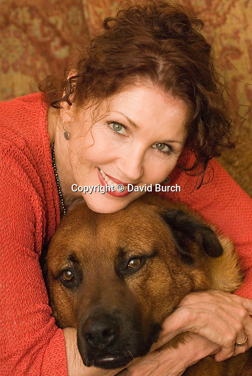 Beautiful mature woman with her pet dog
