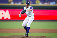 Winston-Salem Dash starting pitcher Carson Fulmer (16) makes a pick-off throw to first base against the Carolina Mudcats at BB&T Ballpark on July 23, 2015 in Winston-Salem, North Carolina.  The Dash defeated the Mudcats 3-2.  (Brian Westerholt/Four Seam Images)