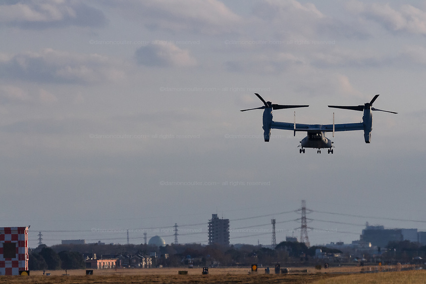 A Bell Boeing V22 Osprey tilt-rotor aircraft with the US Marines, takes-off from Naval Air Facility Atsugi in Yamato, Kanagawa, Japan. Friday January 4th 2019. The Osprey is a controversial transport aircraft. With a patchy safety record it is often the focus of anti-US base and forces protests in Japan, especially in Okinawa. It is a rare visitor to this Atsugi Base.