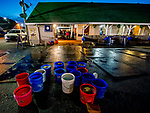 LOUISVILLE, KENTUCKY - APRIL 29: Buckets of water sit at the ready to give horses baths after exercising at Churchill Downs in Louisville, Kentucky on April 29, 2019. Scott Serio/Eclipse Sportswire/CSM