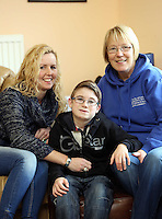 Pictured L-R: Volunteer Allison Morgan with 10 year old James Morris and his mother Diane Morris who is also a volunteer. Monday 17 March 2014<br />