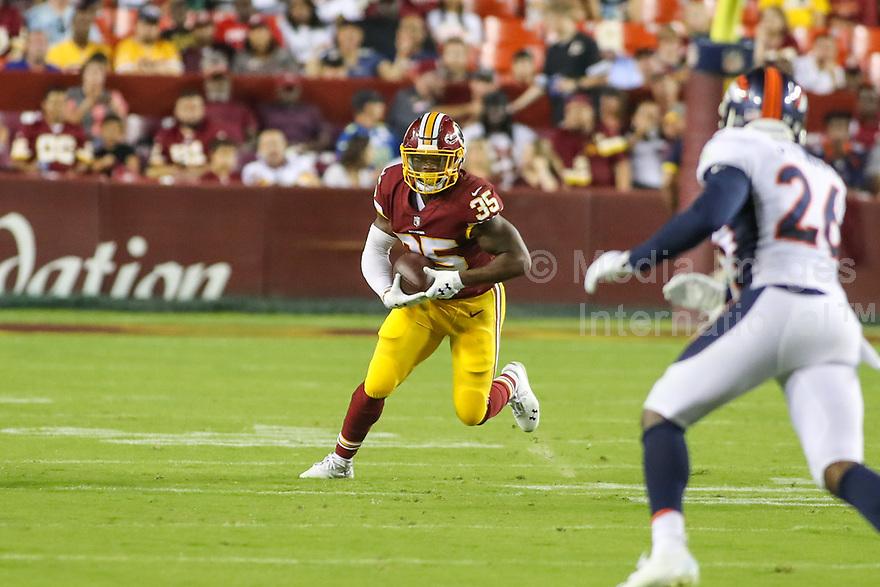 Landover, MD - August 24, 2018: Washington Redskins running back Kapri Bibbs (35) runs the ball during the preseason game between Denver Broncos and Washington Redskins at FedEx Field in Landover, MD.   (Photo by Elliott Brown/Media Images International)
