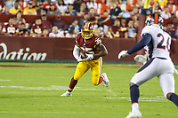 Landover, MD - August 24, 2018: Washington Redskins running back Kapri Bibbs (35) runs the ball during the preseason game between Denver Broncos and Washington Redskins at FedEx Field in Landover, MD.   (Photo by Elliott Brown/Media Images International)