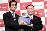 November 1, 2012, Tokyo, Japan - Yasuyuki Higuchi, left, president and CEO of Microsoft Japan, and Kaoru Kato, president of Japan's NTT DoCoMo, show newly-released Windows 8 during a news conference in Tokyo on Thursday, November 1, 2012. DoCoMo, Japan's leading cellular phone carrier, and Microsoft Japan have agreed to work together aiming to incorporate Windows 8-powered tablet computers with DoCoMo's extra high speed LTE mobile service in the corporate computer market. (Photo by AFLO) UUK -mis-