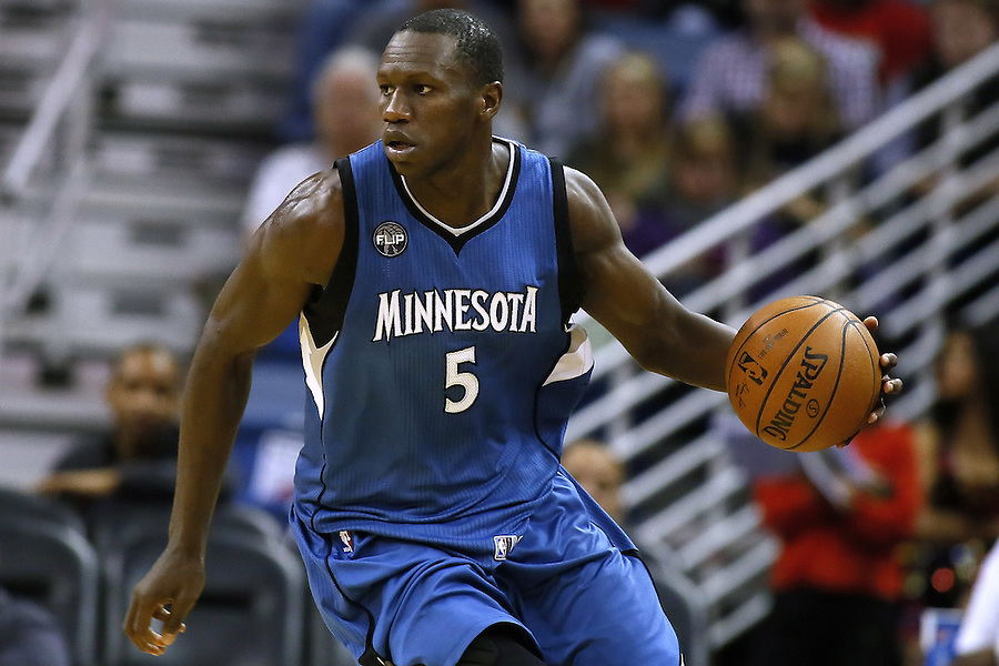 Minnesota Timberwolves center Gorgui Dieng (5) drives with the ball during the second half of an NBA basketball game Saturday, Feb. 27, 2016, in New Orleans. The Timberwolves won 112-110. (AP Photo/Jonathan Bachman)