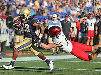 Annapolis, MD - September 23, 2017: Navy Midshipmen running back Josh Brown (28) gets tackled by Cincinnati Bearcats safety Carter Jacobs (20) during the game between Cincinnati and Navy at  Navy-Marine Corps Memorial Stadium in Annapolis, MD.   (Photo by Elliott Brown/Media Images International)