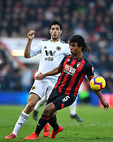 Nathan Ake of AFC Bournemouth holds off Raul Jimenez of Wolverhampton Wanderers during AFC Bournemouth vs Wolverhampton Wanderers, Premier League Football at the Vitality Stadium on 23rd February 2019