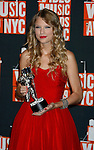 NEW YORK, New York - September 13: Taylor Swift poses in the press room at the 2009 MTV Video Music Awards at Radio City Music Hall on September 13, 2009 in New York City.