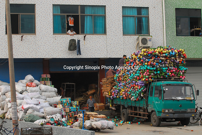 """Datang Sock Town"" in Zhuji City, Zhejiang Province, China. The town in Zhejiang Province makes more than 5.3 billion pairs of socks annually - that 2.5 pairs for every human alive. Most people in the town make a living directly connected to the sock weaving industry..14 Jun 2006"