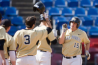 Mike Murray #15 of the Wake Forest Demon Deacons is congratulated by teammates after hitting a home run against the Xavier Musketeers at Wake Forest Baseball Park March 7, 2010, in Winston-Salem, North Carolina.  Photo by Brian Westerholt / Four Seam Images