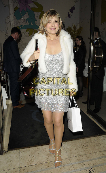 Penny Smith.attended the Costa Book Of The Year Award 2012, Quaglino's, London, England..January 29th, 2013.full length white fur jacket silver dress sequins sequined goody bag black purse .CAP/CAN.©Can Nguyen/Capital Pictures.