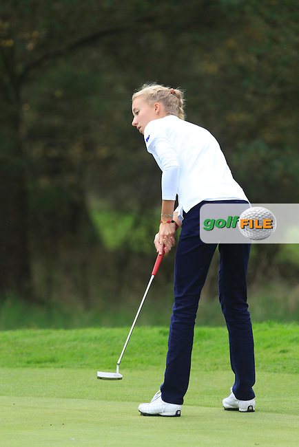 Alexandra Forsterling (GER) on the 5th hole of the Mixed Fourballs, puts to go two up during the 2014 JUNIOR RYDER CUP at the Blairgowrie Golf Club, Perthshire, Scotland. <br /> Picture:  Thos Caffrey / www.golffile.ie