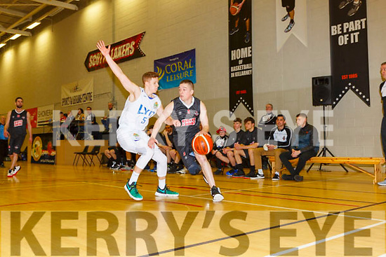 Philip O'Connor Scotts Lakers goes past Dillon Muldoon Donegal during their game in Killarney Saturday night