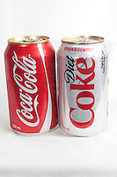 A coca-cola and Diet coke can over a white background