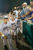 South Carolina catcher Kyle Enders carries the championship trophy following Game Two of the NCAA Division One Men's College World Series Finals on June 29th, 2010 at Johnny Rosenblatt Stadium in Omaha, Nebraska.  (Photo by Andrew Woolley / Four Seam Images)