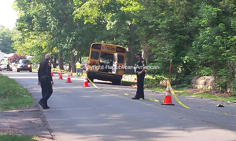 WOLCOTT, CT - May 8, 2015 - 05082015LX01 - Police investigate at the scene of a bus accident on Todd Road on Monday.