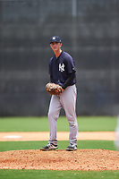 GCL Yankees East relief pitcher Aaron McGarity (21) gets ready to deliver a pitch during the second game of a doubleheader against the GCL Yankees West on July 19, 2017 at the Yankees Minor League Complex in Tampa, Florida.  GCL Yankees West defeated the GCL Yankees East 3-1.  (Mike Janes/Four Seam Images)