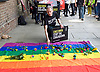Peter Tatchell laying a flower on the rainbow flag <br /> <br /> Amnesty International UK<br /> CHECHNYA: STOP ABDUCTING AND KILLING GAY MEN<br /> protest at the Russian Embassy, London, Great Britain <br /> 2nd June 2017 <br /> <br /> Over a hundred men suspected of being gay have been abducted, tortured and some even killed in the southern Russian republic of Chechnya.<br /> <br /> The Chechen government won&rsquo;t admit that gay men even exist in Chechnya, let alone that they ordered what the police call 'preventive mopping up' of people they deem undesirable. We urgently need your help to call out the Chechen government on the persecution of people who are, as they put it, of 'non-traditional orientation', and urge immediate action to ensure their safety.<br /> <br /> Photograph by Elliott Franks <br /> Image licensed to Elliott Franks Photography Services