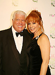 "Country Singer Reba McEntire  poses with Dennis Basso at the 15th Annual QVC presents ""FFANY Shoes on Sale"" which benefits Breast Cancer Research on October 15, 2008 at the Waldorf Astoria, New York City, New York. (Photo by Sue Coflin/Max Photos)"