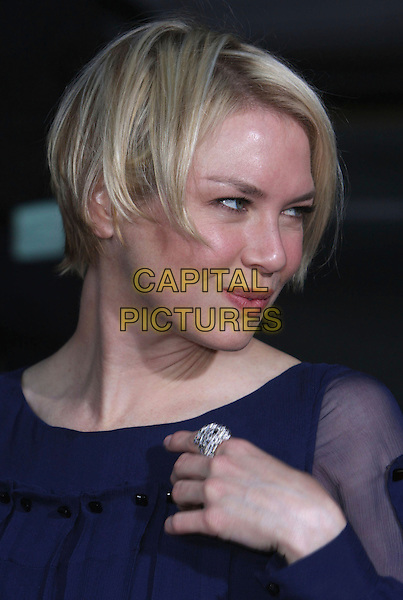 "RENEE ZELLWEGER .""Leatherheads"" World Premiere held at Grauman's Chinese Theatre, Hollywood, California, USA, 31 March 2008..portrait headshot navy blue profile hand ring .CAP/ADM/`CH.©Charles Harris/Admedia/Capital PIctures"