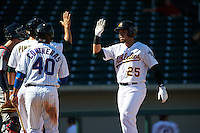 Mesa Solar Sox third baseman Renato Nunez (25) high fives Chad Pinder (10) and Willson Contreras (40) after hitting a home run during an Arizona Fall League game against the Scottsdale Scorpions on October 19, 2015 at Sloan Park in Mesa, Arizona.  Scottsdale defeated Mesa 10-6.  (Mike Janes/Four Seam Images)