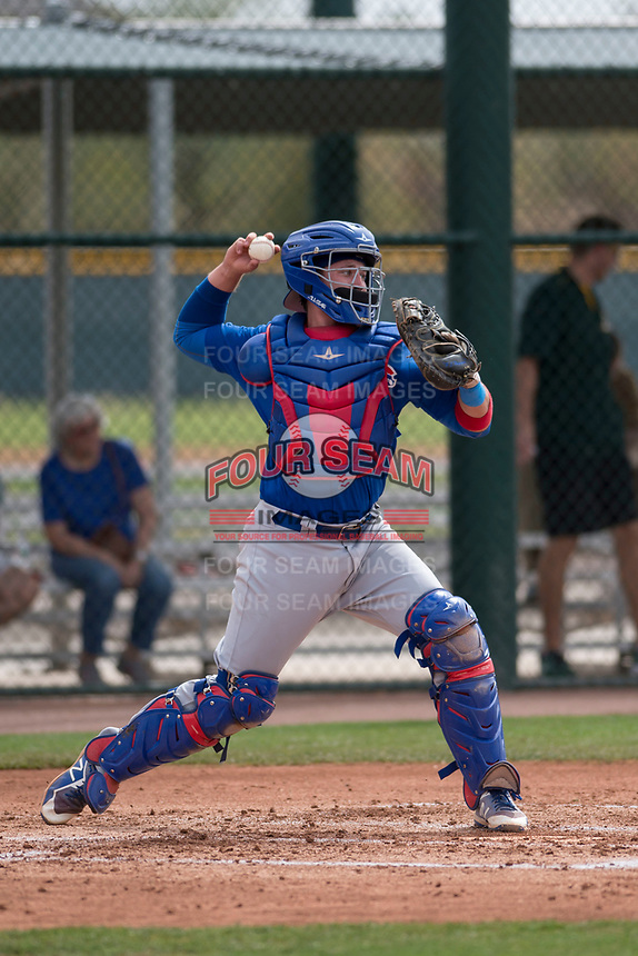 Chicago Cubs catcher PJ Higgins (13) warms up between innings a Minor League Spring Training game against the Oakland Athletics at Sloan Park on March 13, 2018 in Mesa, Arizona. (Zachary Lucy/Four Seam Images)