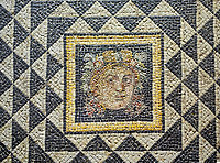 "Roman Dionysus mosaic from the house of Oceanos, Zeugma archaeological site. 2nd - 3rd century AD . Zeugma Mosaic Museum, Gaziantep, Turkey.<br /> <br /> This is the floor (base) mosaic of a room of House of Okeanos. This is among the first pieces of those that excavated from ancient Zeugma city and known for Dionysus Bust and ""meeting of Dionysus and Ariadne'. This mosaic is consisted of three panels. On the left side of this partly damaged art work, there has been the bust of god Dionysus. Through the white and black triangles around Dionysus, a virtual perspective had been created to get a focus on the figure."