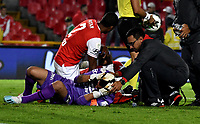 BOGOTA-COLOMBIA, 08-03-2020: Leandro Castellanos,  de Independiente Santa Fe, recibe atencion medica por lesion durante partido de la fecha 8 entre Independiente Santa Fe y Atletico Nacional, por la Liga BetPLay DIMAYOR I 2020, en el estadio Nemesio Camacho El Campin de la ciudad de Bogota. / Leandro Castellanos of Independiente Santa Fe, receive medical attention due to injury during a match of the 8th date between Independiente Santa Fe and Atletico Nacional, for the BetPlay DIMAYOR I Leguaje 2020 at the Nemesio Camacho El Campin Stadium in Bogota city. / Photo: VizzorImage / Luis Ramirez / Staff.