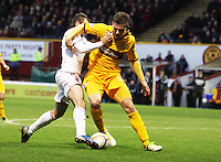 Niall McGinn (left) and Shaun Hutchinson chase for the ball in the Motherwell v Aberdeen, Clydesdale Bank Scottish Premier League match at Fir Park, Motherwell on 26.12.12.