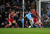 9th January 2018, Etihad Stadium, Manchester, England; Carabao Cup football, semi-final, 1st leg, Manchester City versus Bristol City; Raheem Sterling of Manchester City tries to turn past Bailey Wright of Bristol City