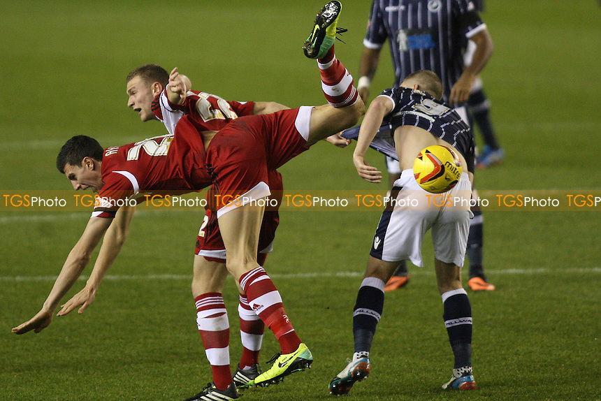 Daniel Sanchez Ayala and Ben Gibson of  Middlesbrough battle with Steve Morison of Millwall - Millwall vs Middlesbrough - Sky Bet Championship Football at the New Den, Bermondsey, London - 21/12/13 - MANDATORY CREDIT: George Phillipou/TGSPHOTO - Self billing applies where appropriate - 0845 094 6026 - contact@tgsphoto.co.uk - NO UNPAID USE