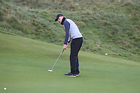 Gavan Keogh (Galway) on the 17th green during Round 2 of the Ulster Boys Championship at Portrush Golf Club, Portrush, Co. Antrim on the Valley course on Wednesday 31st Oct 2018.<br /> Picture:  Thos Caffrey / www.golffile.ie<br /> <br /> All photo usage must carry mandatory copyright credit (&copy; Golffile | Thos Caffrey)
