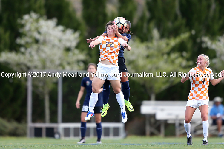 CHARLOTTE, NC - MARCH 25: Tennessee's Katie Cousins (22) and Courage's Debinha (BRA) (behind) challenge for a header. The NWSL's North Carolina Courage played their first preseason game against the University of Tennessee Volunteers on March 25, 2017, at Queens University of Charlotte Sports Complex in Charlotte, NC. The Courage won the match 3-0.