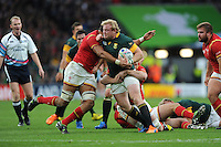 A determined Adriaan Strauss of South Africa is tackled by Taulupe Faletau of Wales during Match 41 of the Rugby World Cup 2015 between South Africa and Wales - 17/10/2015 - Twickenham Stadium, London<br /> Mandatory Credit: Rob Munro/Stewart Communications