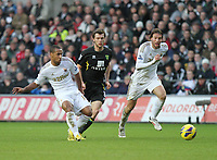 Barclays Premier League, Swansea City (White) V Norwich City (black) Liberty Stadium, Swansea, 08/12/12<br /> Pictured: Swansea's Wayne Routledge feeds the ball through for Michu<br /> Picture by: Ben Wyeth / Athena <br /> Athena Picture Agency<br /> info@athena-pictures.com