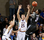SIOUX FALLS, SD - DECEMBER 27:  Reed Tellinghuisen #23 and Lane Severyn #25 from South Dakota State University apply pressure as Quavius Copeland #24 from Middle Tennessee State shoots in the first half of their game at the Sanford Pentagon December 27, 2015 in Sioux Falls, South Dakota. (Photo by Dave Eggen/Inertia)