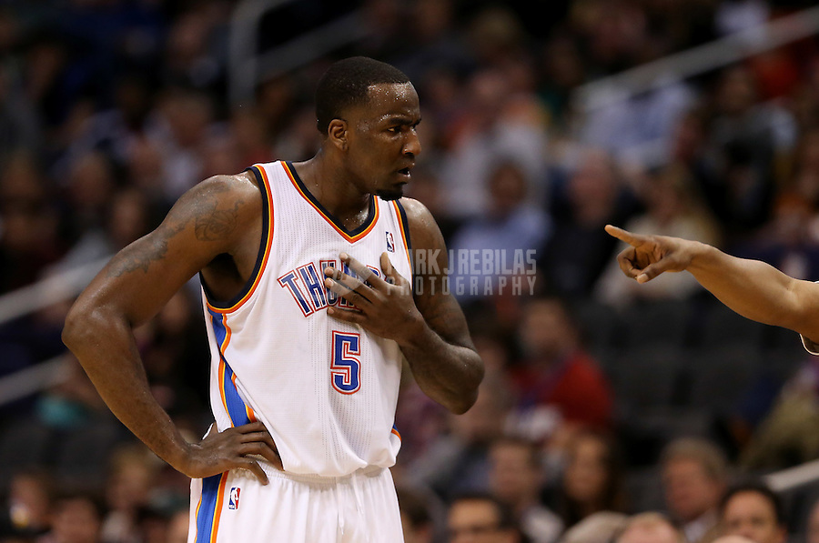 Feb. 10, 2013; Phoenix, AZ, USA: Oklahoma City Thunder center Kendrick Perkins reacts after being called for a technical foul in the second quarter against the Phoenix Suns at the US Airways Center. Mandatory Credit: Mark J. Rebilas-