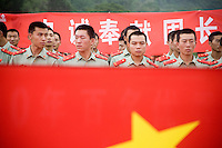 Young army soldiers pose for pictures at the Great Wall at Badaling outside Beijing, China.