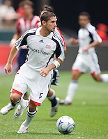 New England Revolution defender Jay Heaps (6) looks for a teammate dribbling downfield during a MLS game. The New England Revolution defeated the Chivas USA 2-1 at Home Depot Center Stadium, in Carson, Calif., on Sunday, May 11, 2008.