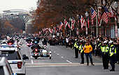 Crowds line Pennsylvania Ave. as the motorcade with the flag-draped casket of former President George H.W. Bush is driven from the Capitol by the White House and on to the State Funeral at the National Cathedral, Wednesday, Dec. 5, 2018, in Washington. <br /> Credit: Alex Brandon / Pool via CNP