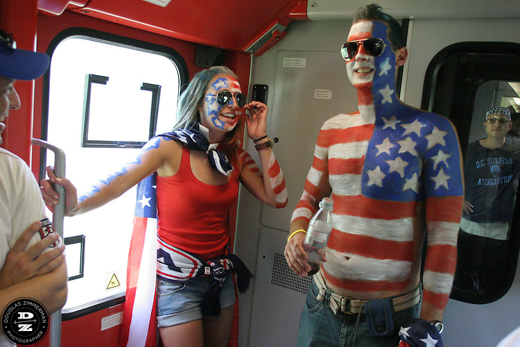 USA National Soccer Team fans Rachael Rothenbach of Cincinnatti, OH and Michael White of Livonia, MI share a laugh while riding on an overcrowded train from Dusseldorf to Gelsenkirchen on Monday June 12th, 2006. They were traveling to attend the FIFA World Cup First round match of the USA against the Czech Republic.  The United States lost lost the match 3-0.